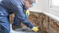 Inserting Dryrods into the wall to form a damp-proof course